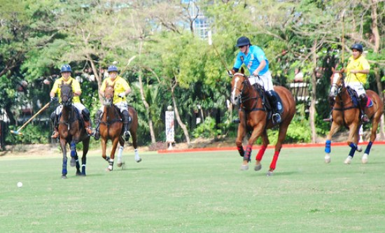 Blues battle against the Yellows during the Low Goal game of FILA Polo Cup 2013 at the Manila Polo Club.