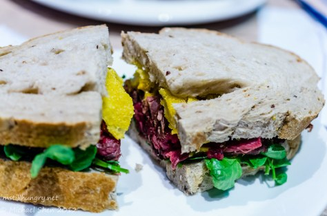 Reuben & Moore The Kate Sandwich - rare roast beef, onion rings & mustard
