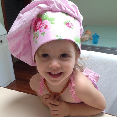 Baking with Mummy in nothing but a nappy, hat and apron... As you do...