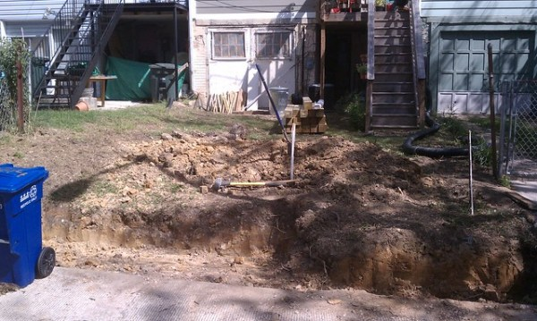 Backyard excavated for wall