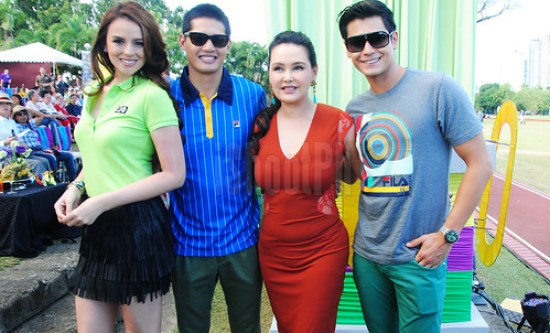 FILA Queen and CEO Cris Abert (in orange dress) together with FILA endorsers Georgina Wilson, Borgy Manotoc, and Fabio Ide during FILA Polo Cup 2013.