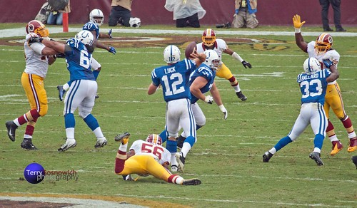 Colts QB Andrew Luck avoids LB Perry Riley and looks to throw.