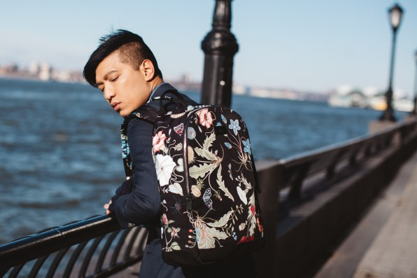 Bryanboy carrying a canvas printed Gucci backpack by Kris Knight