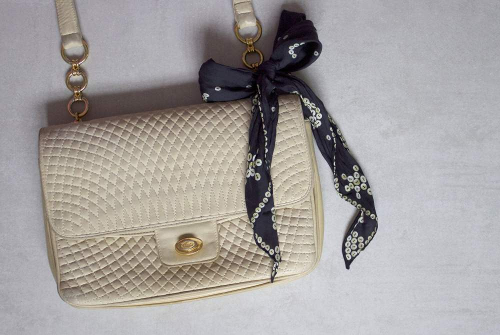 vintage bally handbag with cleo ferin mercury scarf pearly queen and king print scarf button bow scarf on handbag