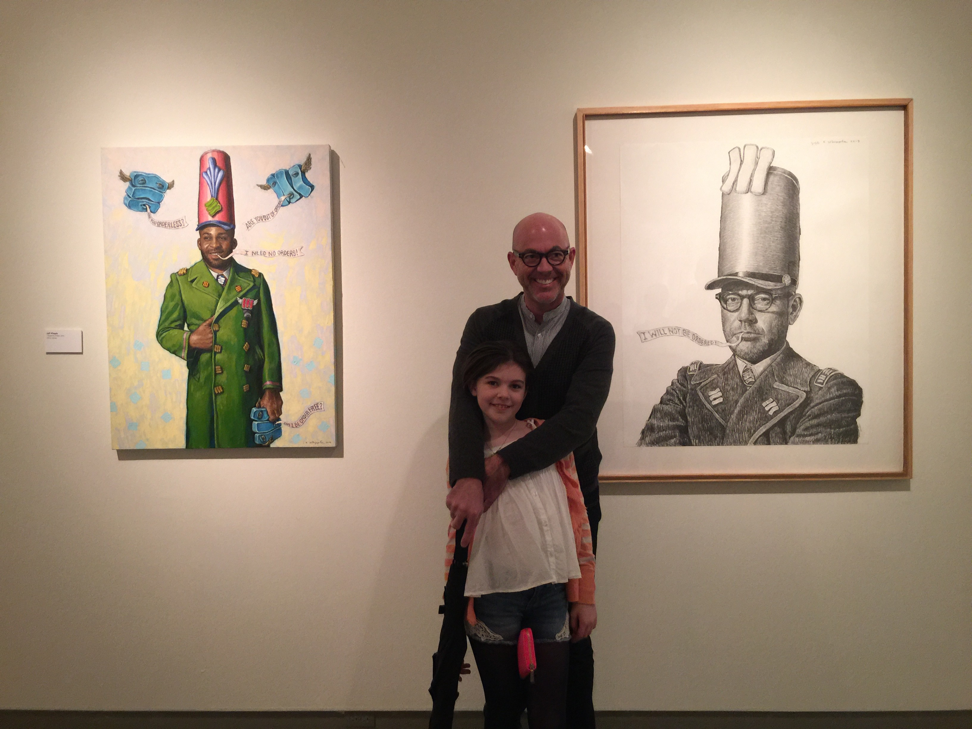 My dad, Steve Williams, and sister, Avery, standing with Jeff Whipple's art at MOCA