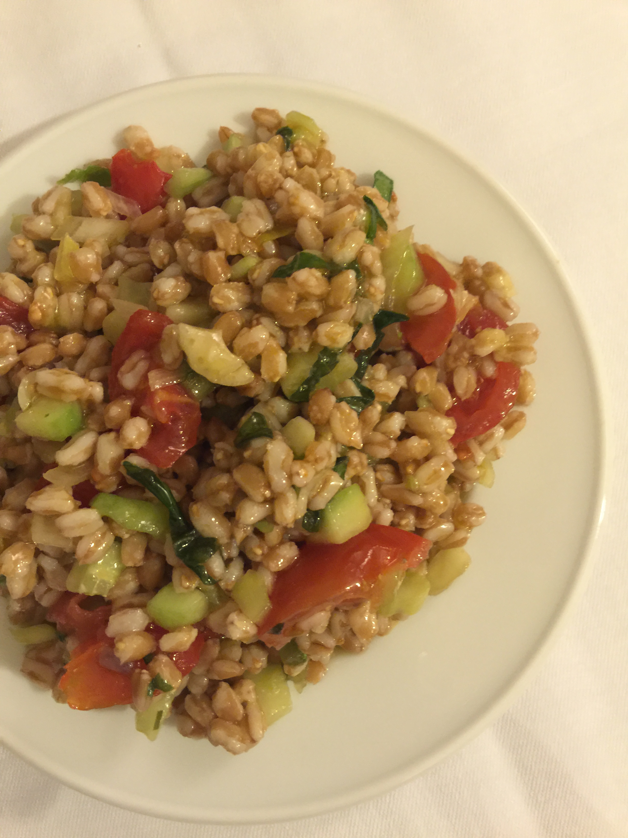 Cracked wheat salad with tomato, cucumber, and olive oil