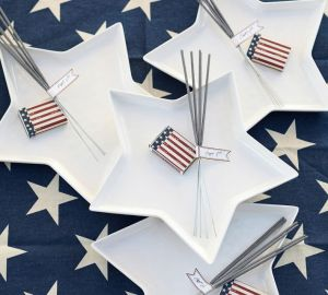 I love how PotteryBarn accented these plates with sparklers & matches - I may have to do the same