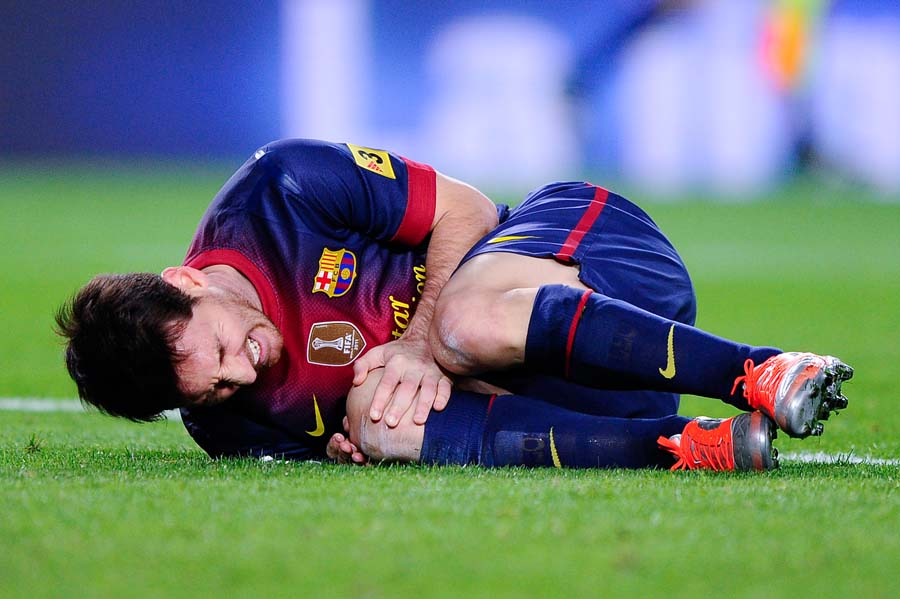 BARCELONA, SPAIN - NOVEMBER 03: Lionel Messi of FC Barcelona reacts on the picth after being tackled during the La Liga match between FC Barcelona and RC Celta de Vigo at Camp Nou on November 3, 2012 in Barcelona, Spain. (Photo by David Ramos/Getty Images)