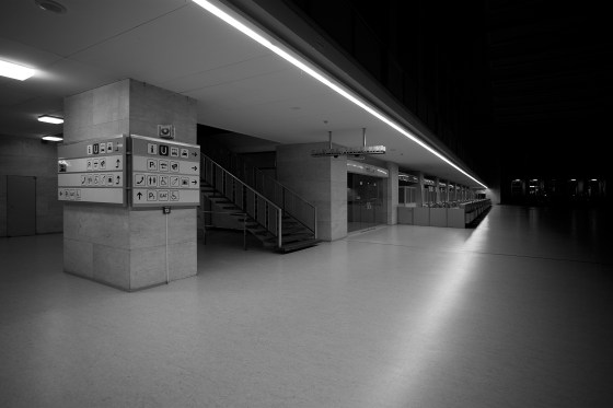 Wayfinding signage and check-in desks at Berlin Tempelhof Airport