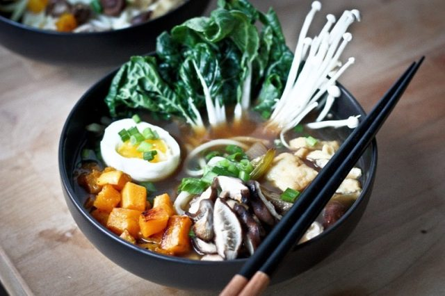 A warming bowl of  Ramen with a flavorful VEGAN Shiitake Broth, smoked mushrooms ( optional)  roasted veggies, wilted greens and tofu. | www.feastingathome.com