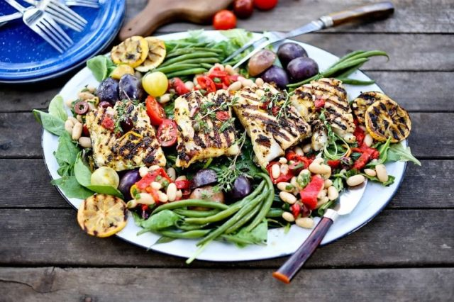 Grilled Summer Nicoise Salad w/ fresh grilled fish, baby potatoes, olives, roasted peppers, french beans & lemony mustard seed vinaigrette. Gluten free and Healthy! |www.feastingathome.com