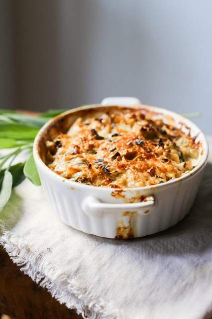 Creamy Cauliflower Gratin with garlic an sage...the perfect holiday side dish| www.feastingathome.com