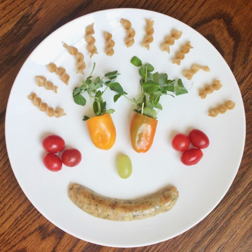 dinner served as a silly face to encourage picky eaters to eat healthy