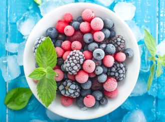 Frozen berry on turquoise  background top view
