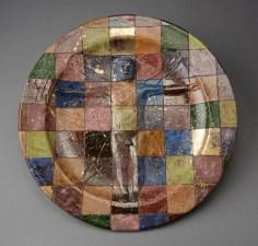 "Robert Arneson, ""A Question of Measure or Checkered Plate or Vitruvian Man"" 1978, ceramic, luster glaze, 18.25"". (Pennington)"