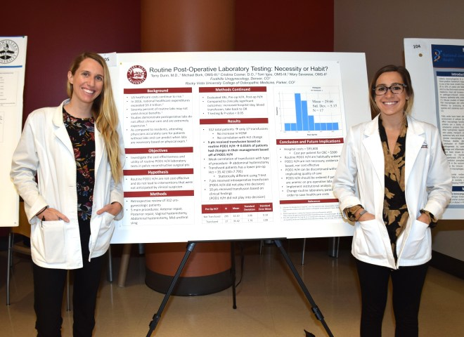 Torri Igou, OMS III, and Mary Savarese, OMS II, preset their research during the poster session.