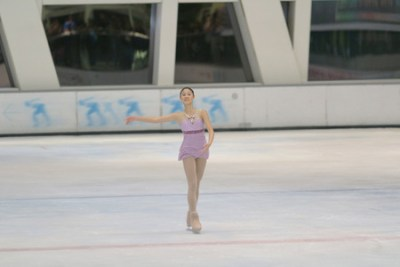 50390709 - little girl figure skating at sports arena