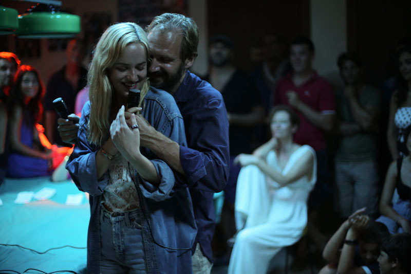 "Dakota Johnson as ""Penelope"" and Ralph Fiennes as ""Harry"" in A B"