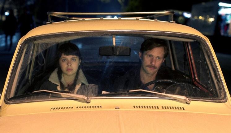 Left to right: Bel Powley as Minnie Goetze and Alexander Skarsgård as Monroe