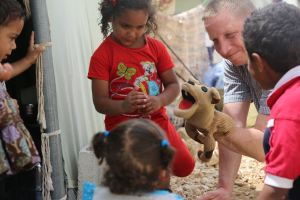 Rocko, Scott and new friends at Syrian camp in 2013