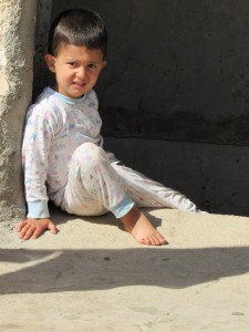 Yazidi child in doorway