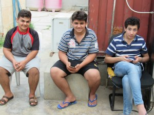 Teens, refugees from Mosul area, hanging out in Kirkuk Church courtyard