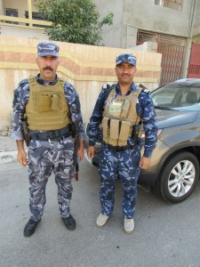 Iraqi Police guarding area outside Protestant church