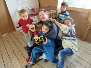 Scott and Rocko with Sunni children at a Syrian refugee camp