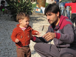 Sunni Dad with his son at a Syrian refugee camp