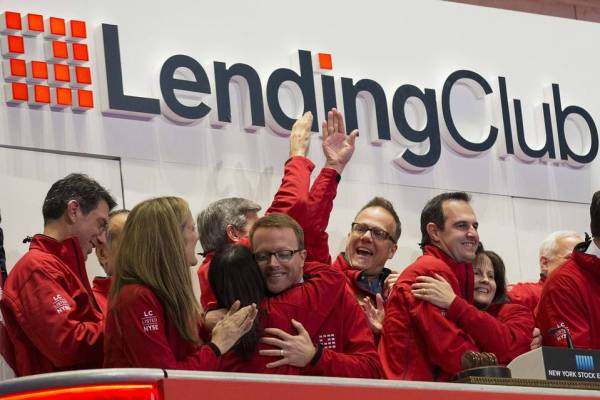 Renaud Laplanche, (2nd R) Founder and CEO of Lending Club, celebrates with company executives after ringing the opening bell during their IPO at the New York Stock Exchange December 11, 2014. PHOTO: REUTERS