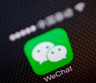 A picture illustration shows a WeChat app icon in Beijing in this December 5, 2013 file photo. Asian chat services KakaoTalk, LINE and WeChat threaten to overturn the mobile order of things, usurping the role of Google Inc, Apple Inc, Amazon.com Inc, Facebook Inc and telecoms carriers as gatekeeper to the consumer. Where these internet and telecoms giants once controlled the lucrative choke points of the industry, social messaging services are fast emerging as an alternative distribution channel for adverts, apps, and goods and services. REUTERS/Petar Kujundzic/Files (CHINA - Tags: BUSINESS POLITICS TELECOMS)