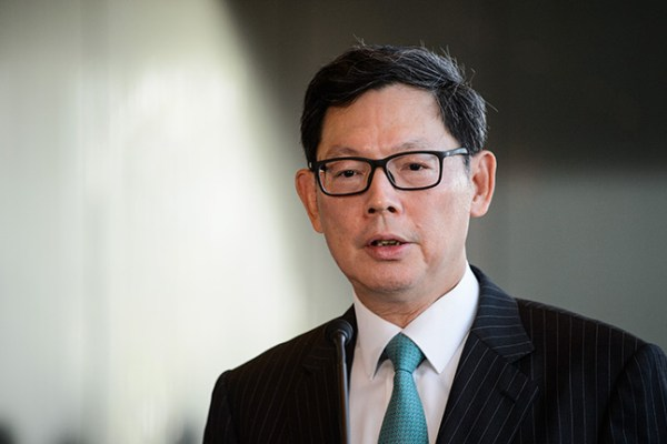 Hong Kong Monetary Authority (HKMA) Chief Executive Norman Chan (R) holds a press conference in Hong Kong on June 24, 2016, following the results of the UK Brexit referendum.  Britain has voted to break out of the European Union, national media declared on June 24, striking a thunderous blow against the bloc and spreading alarm through markets as sterling plummeted to a 31-year low against the dollar. / AFP / ANTHONY WALLACE        (Photo credit should read ANTHONY WALLACE/AFP/Getty Images)