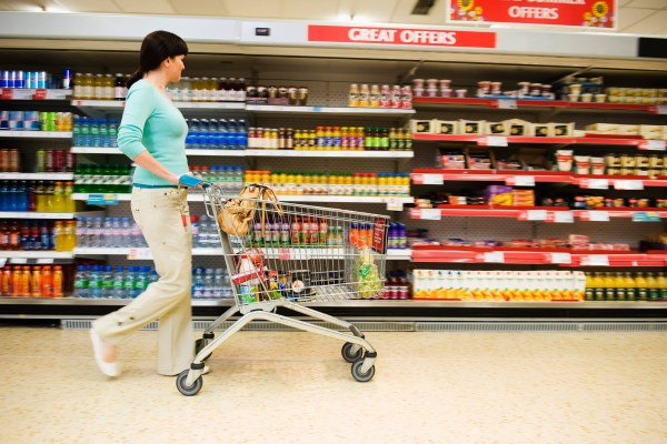 Shopper with Cart in Supermarket --- Image by © Dave & Les Jacobs/cultura/Corbis