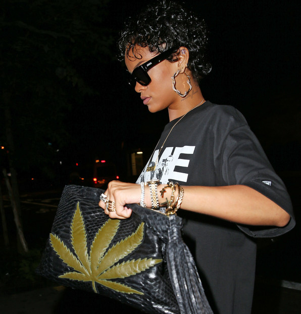 Rihanna wears a FAME t-shirt and carries a hemp plant bag when out and about in NYC