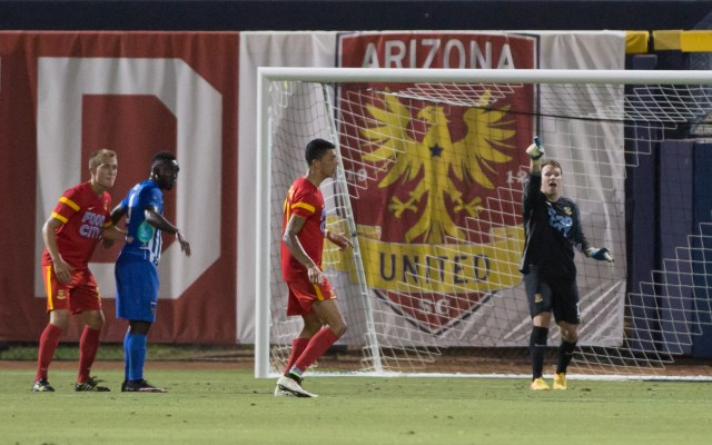 Arizona United goalkeeper Jordan Stagmiller (right) directs his teammates against Orange County Blues FC June 11, 2016 in Peoria (Photo by Michael Rincon)