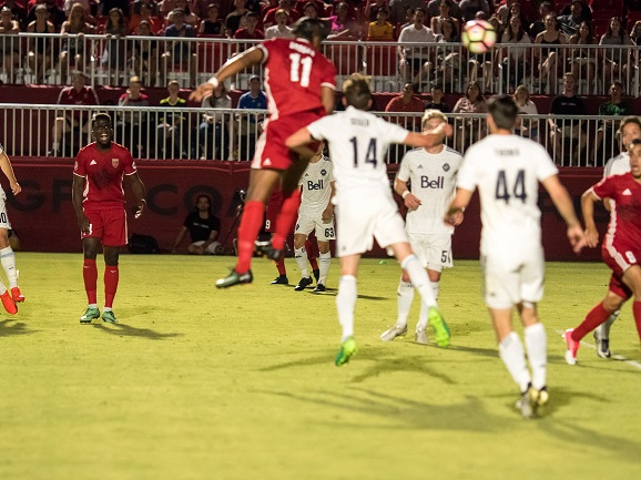 Phoenix Rising FC's Didier Drogba, left, heads the ball into the net in the first half against Whitecaps FC 2 June 10, 2017 at the Phoenix Rising Soccer Complex in Scottsdale, Ariz. Photo by Aaron Blau/Firebird Rising