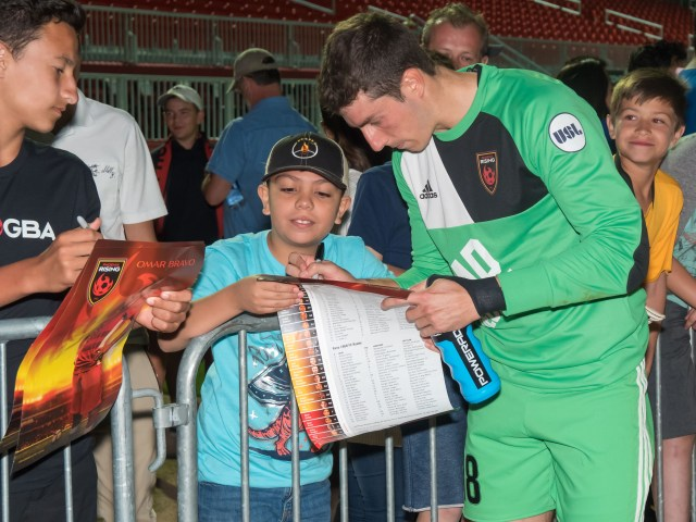 Rising FC keeper Josh Cohen signs autographs after a home match.