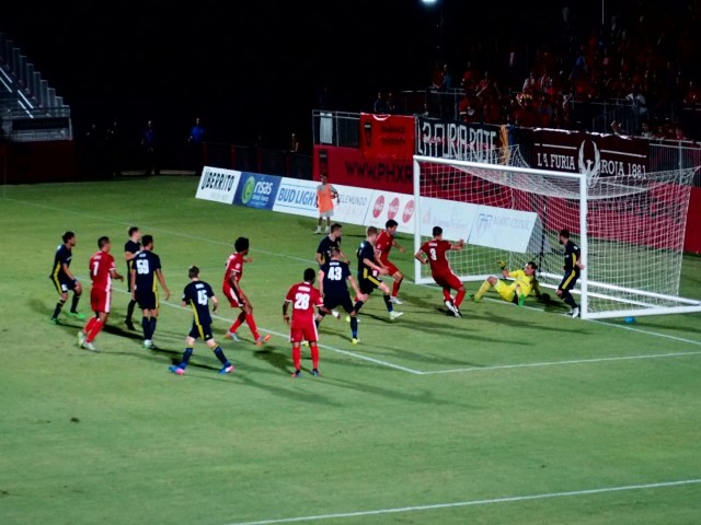 Phoenix Rising FC's Sam Hamilton, top left, scores past Real Monarchs SLC goalkeeper Connor Sparrow, top second from right, in the first half Sept. 6, 2017 at the Phoenix Rising Soccer Complex in Scottsdale, Ariz. Photo by Aaron Blau/Firebird Rising
