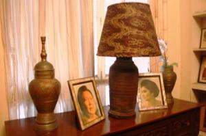 Photos of Ferdinand Marcos and of Imelda Marcos are displayed in each room.