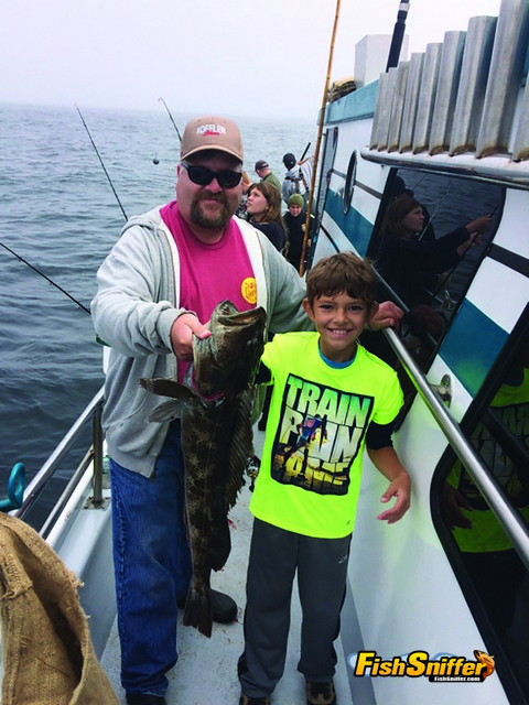 Kaden Cullen gets a hand from his dad Sean showing off the big Golden Gate lingcod he caught aboard the Sea Wolf.