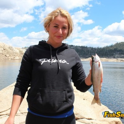 Bank fishing is also superb for the lake's feisty rainbows, as this woman can attest.