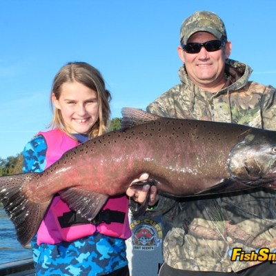 Jeff Bosshard and his daughter, Vivica, pose proudly with the huge king salmon that she landed while fishing the Feather River below the Thermalito Afterbay Outlet with Robert Weese of Northern California Guide Service.