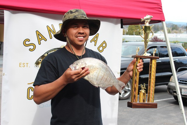Ken Lagudas of Salinas won first place in the men's barred surfperch division of the Sand Crab Classic with this 3.14 lb. fish caught while fishing a bloodworm at the mouth of the Salinas River on March 11.