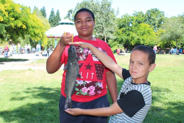 Simmeul Reed and Billy Smith had fun fishing for catfish at Howe Community Park on Free Fishing Day.