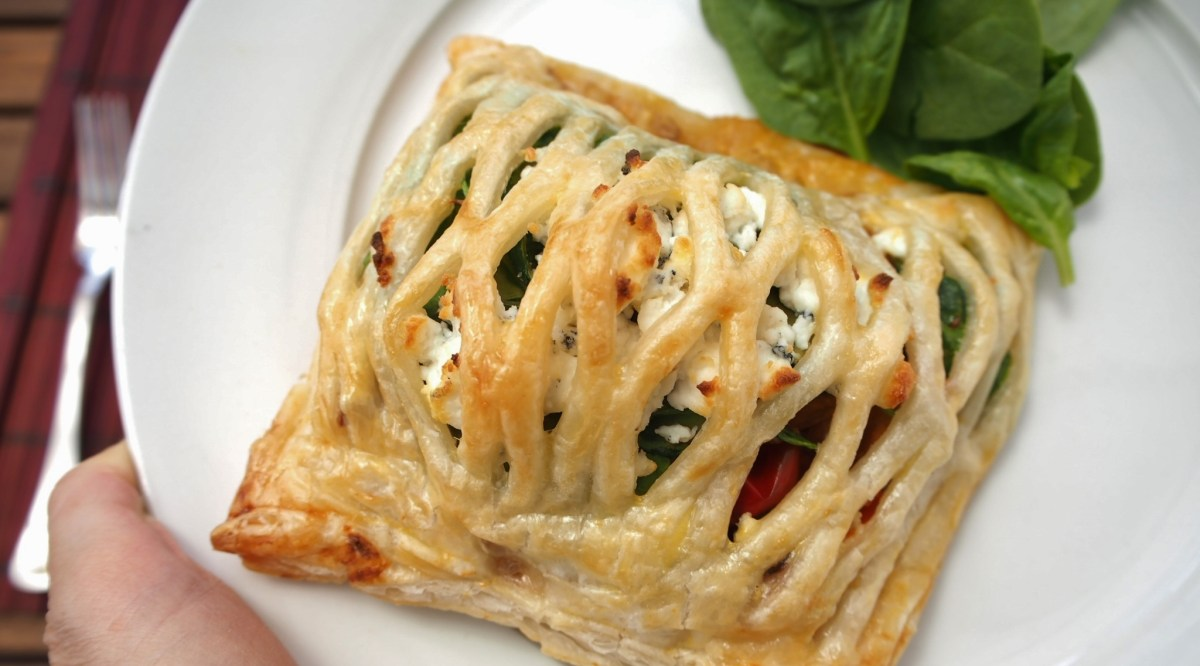 Vegetarian pastry parcels with roast vegetables and goat cheese