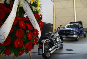 A motorcycle and transient alert truck are displayed during Master Sgt. John Colpoys' memorial service May 22 at Aviano Air Base, Italy. Colpoys, a transient alert technician, died in a May 14 motorcycle accident. U.S. Air Force photo/Airman 1st Class Ryan Conroy