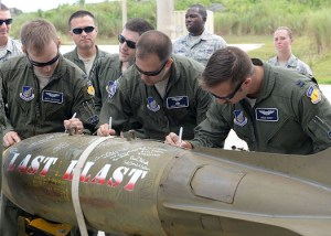 Airmen from the 20th Expeditionary Bomb Squadron sign the 'Last Blast' June 24, 2015 at Andersen Air Force Base, Guam.  (U.S. Air Force photo by Airman 1st Class Joshua Smoot/Released)