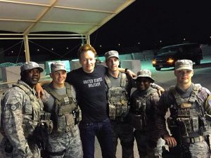 Conan O'Brien poses with troops at Al Udeid Air Base in Qatar on Nov. 2, 2015. (From Michelle Obama's Instagram account)