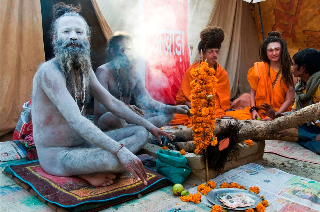 a naga (naked) sadhu with followers from Russia