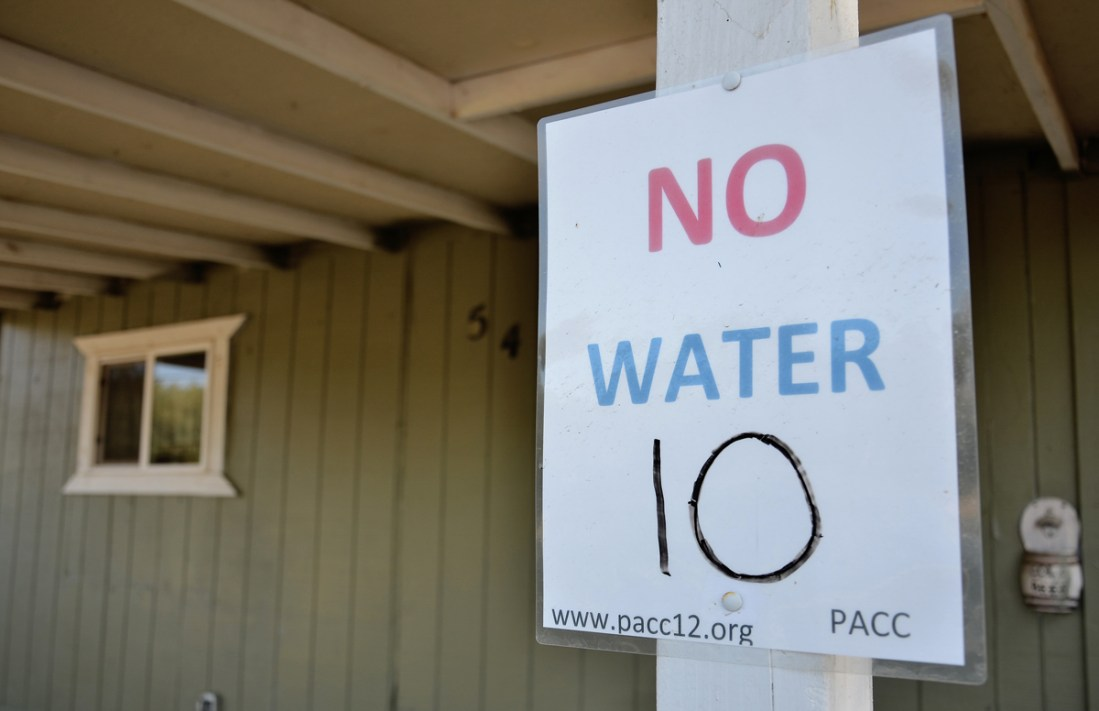 No water sing outside a home in East Porterville.